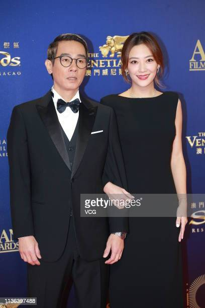 Actor Jordan Chan SiuChun and his wife actress Cherrie Ying Choiyi pose on the red carpet of the 13th Asian Film Awards on March 17 2019 in Hong Kong...