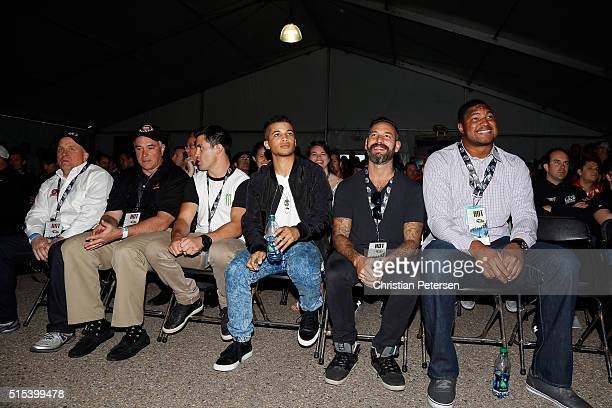 Actor Jordan Fisher UFC fighter Dominick Cruz and Calais Campbell of the Arizona Cardinals sit in at the drivers' meting prior to the NASCAR Sprint...