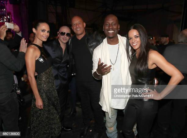 Actor Jordana Brewster musician Pitbull actors Vin Diesel Tyrese Gibson and Michelle Rodriguez attend the 2017 MTV Movie And TV Awards at The Shrine...