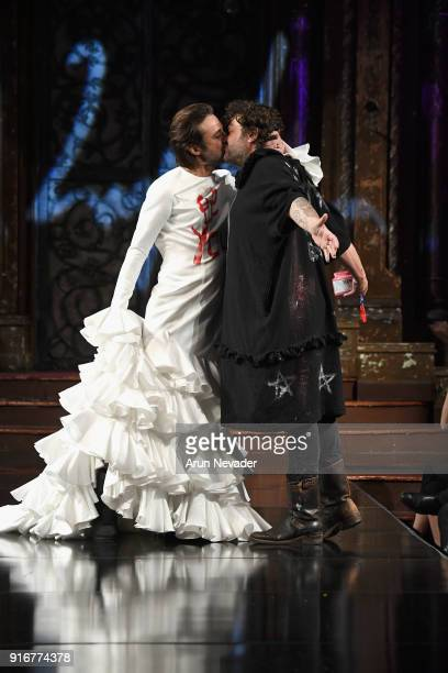 Actor Jordi Moila kisses designer Domingo Zapata on the runway during the Domingo Zapata presentation at New York Fashion Week Powered by Art Hearts...
