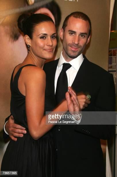 Actor Joseph Fiennes and Maria Dolores Dieguez as they attend the Premiere of the Bille August film Goodbye Bafana on March 21 2007 in Paris France