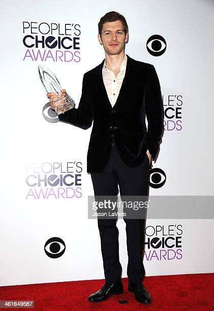 Actor Joseph Morgan poses in the press room at the 40th annual People's Choice Awards at Nokia Theatre L.A. Live on January 8, 2014 in Los Angeles,...