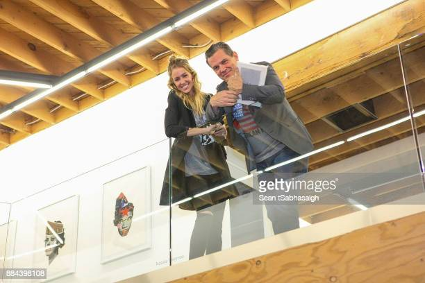 Actor Josh Brolin and wife Kathryn Boyd pose in front of a Brandon Boyd artwork while at OptiMystic A Brandon Boyd Pop Up Gallery Featuring He Tasya...