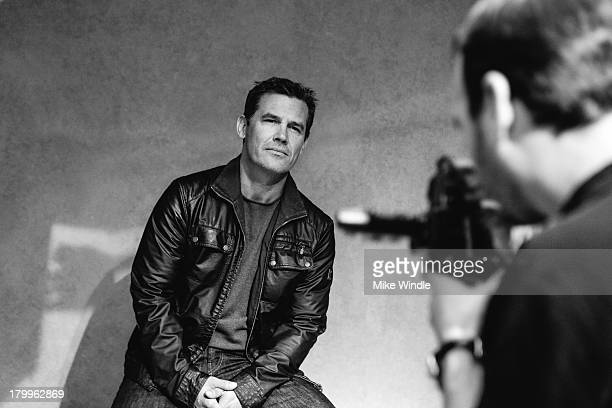 Actor Josh Brolin poses for a portrait with photographer Jeff Vespa during the 2013 Toronto International Film Festival on September 7 2013 in...