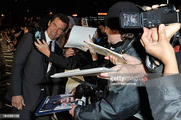 Actor Josh Brolin poses with fan as he arrives to the Mayfair Gala European Premiere of 'Labor Day' during the 57th BFI London Film Festival at Odeon...