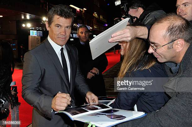 Actor Josh Brolin signs autographs as he arrives to the Mayfair Gala European Premiere of 'Labor Day' during the 57th BFI London Film Festival at...