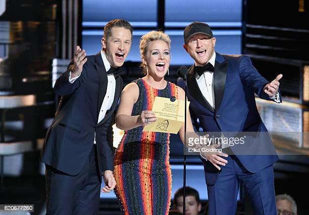 Actor Josh Dallas Singersongwriter Cam and singer Cole Swindell speak onstage during the 50th annual CMA Awards at the Bridgestone Arena on November...