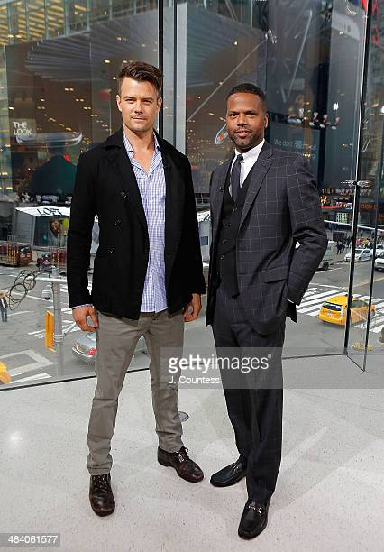 Actor Josh Duhamel and AJ Calloway of 'Extra' pose for a photo during during a taping of 'Extra' at their New York studios at HM in Times Square on...