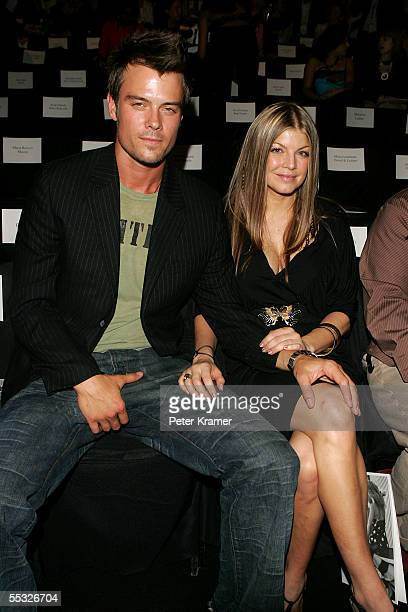 Actor Josh Duhamel and Black Eye Peas Singer Fergie in the front row at the Tommy Hilfiger Spring 2006 fashion show during Olympus Fashion Week at...
