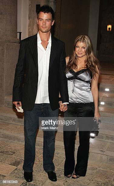 Actor Josh Duhamel and Fergie of Black Eyed Peas attends the Gucci Spring 2006 Fashion Show Benefitting The Childrens Action Network at Michael...