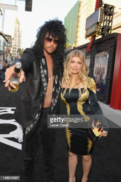 Actor Josh Duhamel and singer Fergie arrive at the Rock of Ages Los Angeles premiere held at Grauman's Chinese Theatre on June 8 2012 in Hollywood...