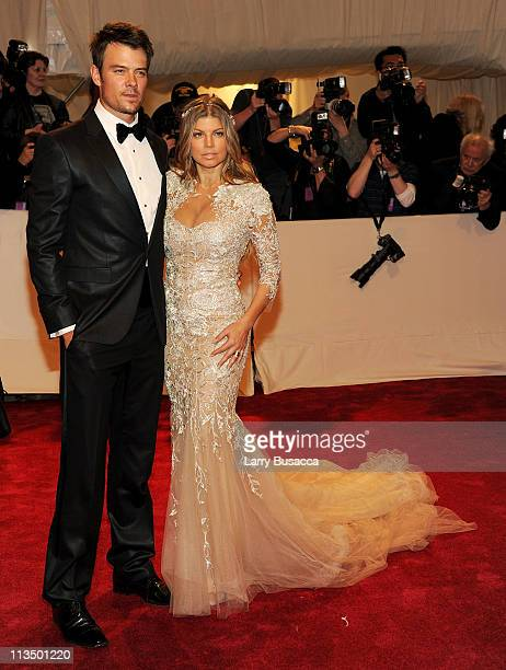 Actor Josh Duhamel and singer Fergie attend the 'Alexander McQueen Savage Beauty' Costume Institute Gala at The Metropolitan Museum of Art on May 2...
