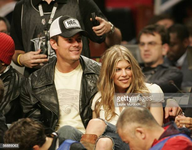 Actor Josh Duhamel and Stacy Fergie Ferguson of The Black Eyed Peas are seen during the 2006 NBA AllStar Game February 19 2006 at the Toyota Center...