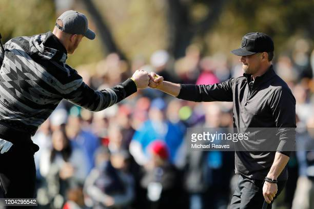 Actor Josh Duhamel celebrates with Kyle Rudolph of the Minnesota Vikings on the first green during the 3M Celebrity Challenge prior to the ATT Pebble...