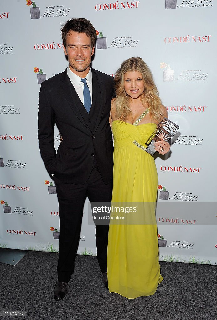 Actor Josh Duhamel (L) poses with singer Fergie backstage with the FiFi New Celebrity Fragrance of the Year Award at the 2011 FiFi Awards at The Tent at Lincoln Center on May 25, 2011 in New York City.