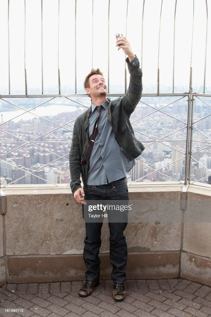 Actor Josh Duhamel takes a 'selfie' picture at The Empire State Building on February 12, 2013 in New York City.
