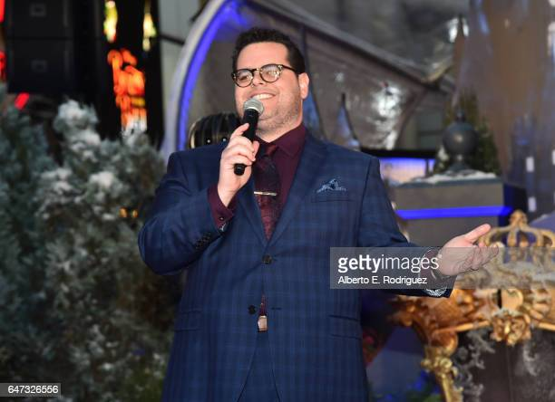 Actor Josh Gad performs at the world premiere of Disney's liveaction 'Beauty and the Beast' at the El Capitan Theatre in Hollywood as the cast and...