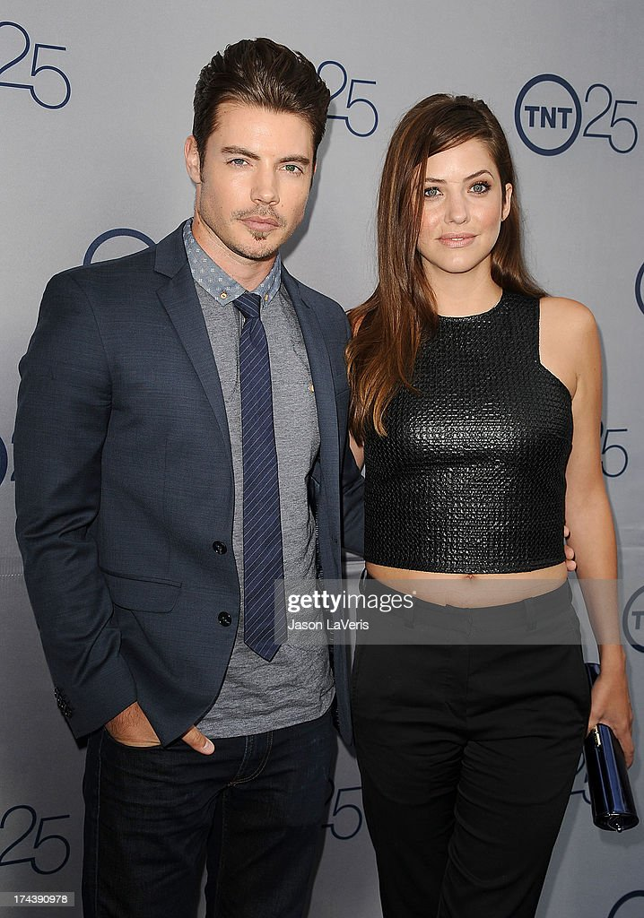 Actor Josh Henderson and actress Julie Gonzalo attend TNT's 25th anniversary party at The Beverly Hilton Hotel on July 24, 2013 in Beverly Hills, California.