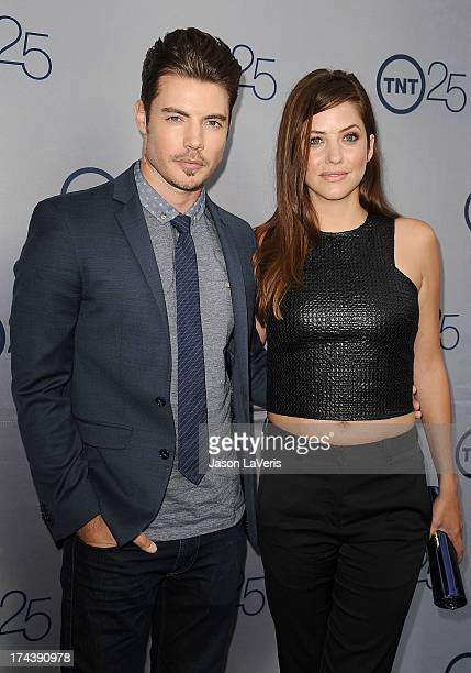 Actor Josh Henderson and actress Julie Gonzalo attend TNT's 25th anniversary party at The Beverly Hilton Hotel on July 24 2013 in Beverly Hills...