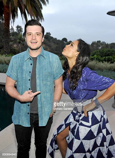 Actor Josh Hutcherson and actress Rosario Dawson attend the launch of Studio 189 for yooxcom Collection at a private residence on May 11 2016 in...