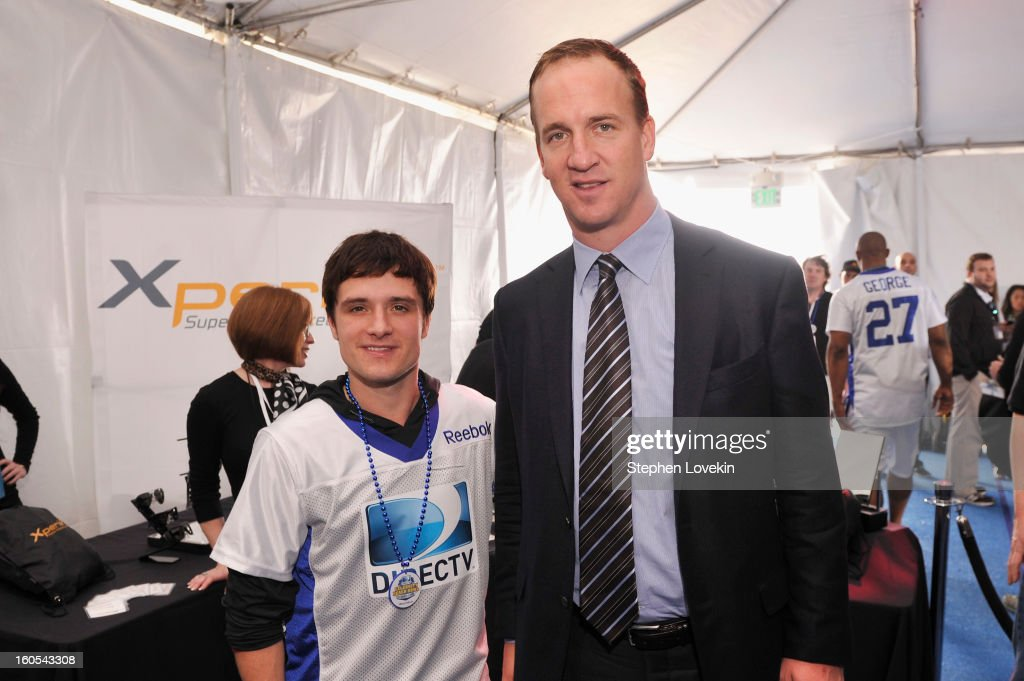 Actor Josh Hutcherson and Peyton Manning attend GBK and DirecTV Celebrity Beach Bowl Thank You Lounge at DTV SuperFan Stadium at Mardi Gras World on February 2, 2013 in New Orleans, Louisiana.