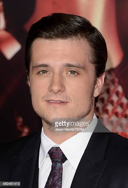 Actor Josh Hutcherson arrives at the premiere of Lionsgate's The Hunger Games Catching Fire at Nokia Theatre LA Live on November 18 2013 in Los...