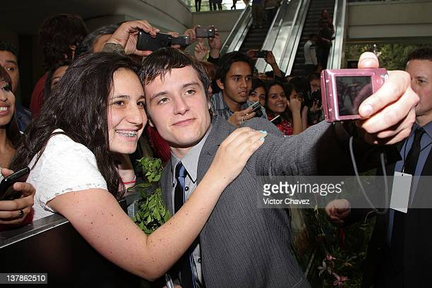 Actor Josh Hutcherson poses for photos and signs autographs to fans during the 'Journey 2 The Mysterious Island' Mexico City red carpet event at...