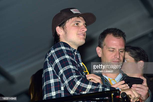 Actor Josh Hutcherson watches rapper Pitbull perform at the Rolling Stone LIVE party held at the Bud Light Hotel on February 1 2013 in New Orleans...
