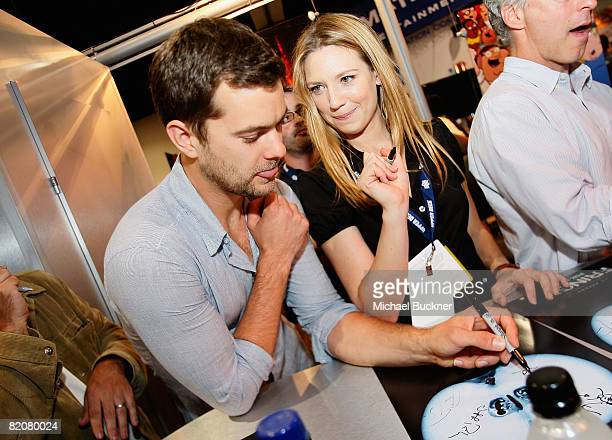Actor Joshua Jackson and actress Anna Tory sign autographs at the 'Fringe' Panel during the 2008 Comic Con at the San Diego Convention Center on July...