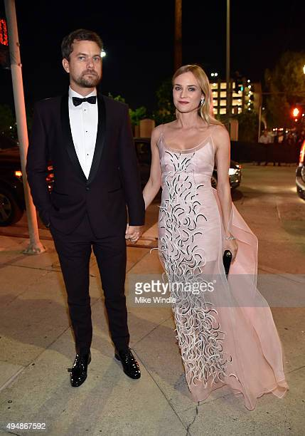 Actor Joshua Jackson and actress Diane Kruger attend amfAR's Inspiration Gala Los Angeles at Milk Studios on October 29 2015 in Hollywood California