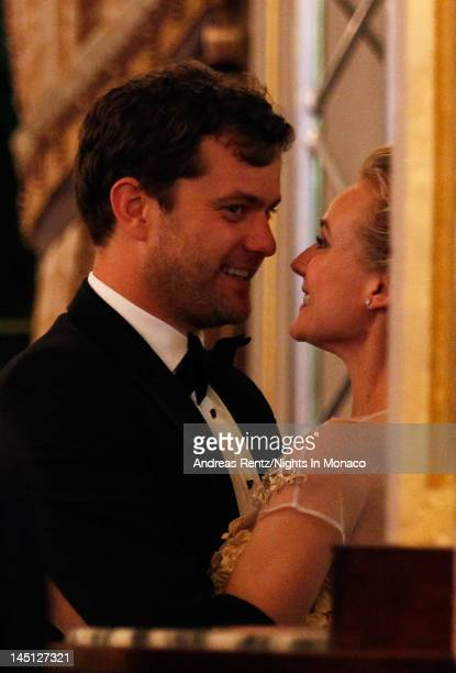 Actor Joshua Jackson and his girlfriend actress Diane Kruger share a moment after Jackson purchased a Carla Amorim necklace in the auction during the...