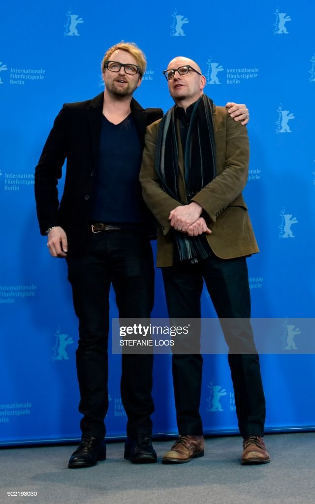 US actor Joshua Leonard and US director Steven Soderbergh pose during the photo call for the film 'Unsane' presented in competition during the 68th edition of the Berlinale film festival in Berlin on February 21, 2018. / AFP PHOTO / Stefanie Loos