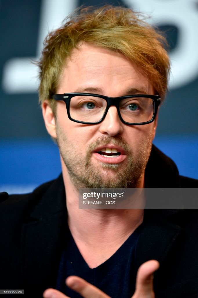 US actor Joshua Leonard speaks during a press conference for the film 'Unsane' presented in competition during the 68th edition of the Berlinale film festival in Berlin on February 21, 2018. / AFP PHOTO / Stefanie Loos