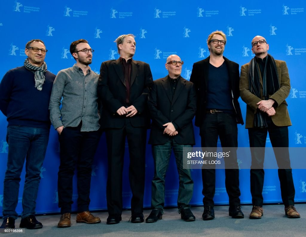 US actor Joshua Leonard (2nd R), US director Steven Soderbergh (R) and cast team pose during the photo call for the film 'Unsane' presented in competition during the 68th edition of the Berlinale film festival in Berlin on February 21, 2018. / AFP PHOTO / Stefanie Loos