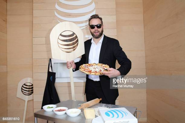 Actor Joshua Locy poses at ATT's Jon Vinny's popup pizza bar at the 2017 Film Independent Spirit Awards sponsored by ATT at Santa Monica Pier on...