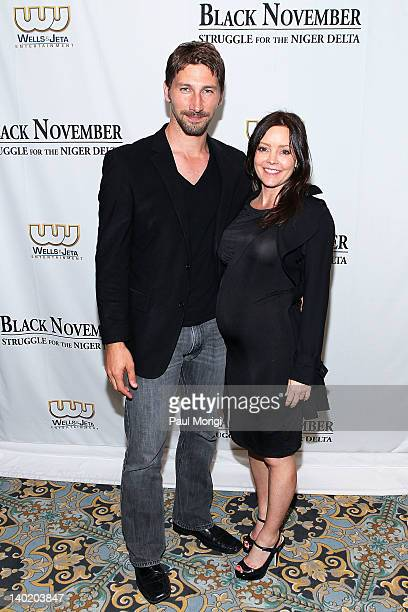 Actor Joshua Smith and Jennifer Brougham attend the 'Black November' film screening at The Library of Congress on February 29 2012 in Washington DC