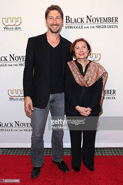 Actor Joshua Smith and Mary Jane Deeb Chief African and Middle East Division Library of Congress attend the 'Black November' film screening at The...