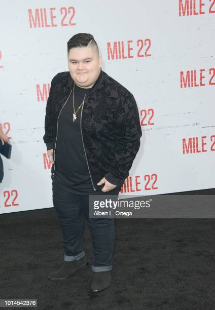 Actor Jovan Armand arrives for the Premiere Of STX Films' 'Mile 22' held at Westwood Village Theatre on August 9 2018 in Westwood California