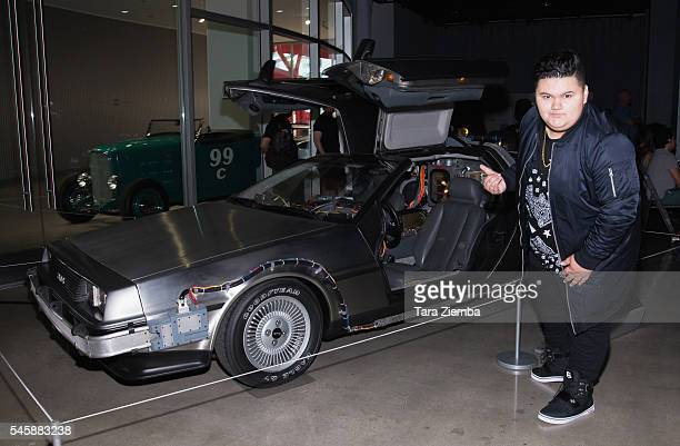 Actor Jovan Armand poses for a photo with the original DeLorean Time Machine Hero A Car at the release of the documentary Outatime Saving The...