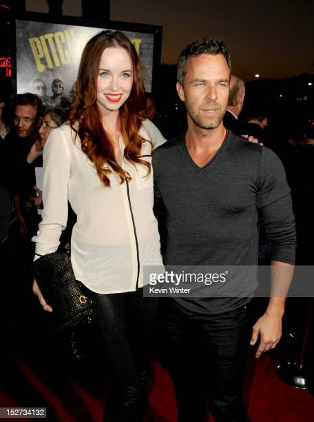 """Actor JR Bourne and guest arrive at the premiere of Universal Pictures And Gold Circle Films' """"Pitch Perfect"""" at ArcLight Cinemas on September 24,..."""