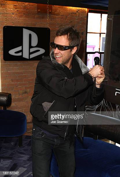 Actor JR Bourne plays a PS3 at the PlayStation Lounge at Silver on January 24, 2011 in Park City, Utah.