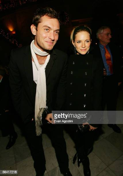 """Actor Jude Law and actress Sienna Miller attend the """"Casanova"""" special screening after party at The Metropolitan Club December 11, 2005 in New York..."""