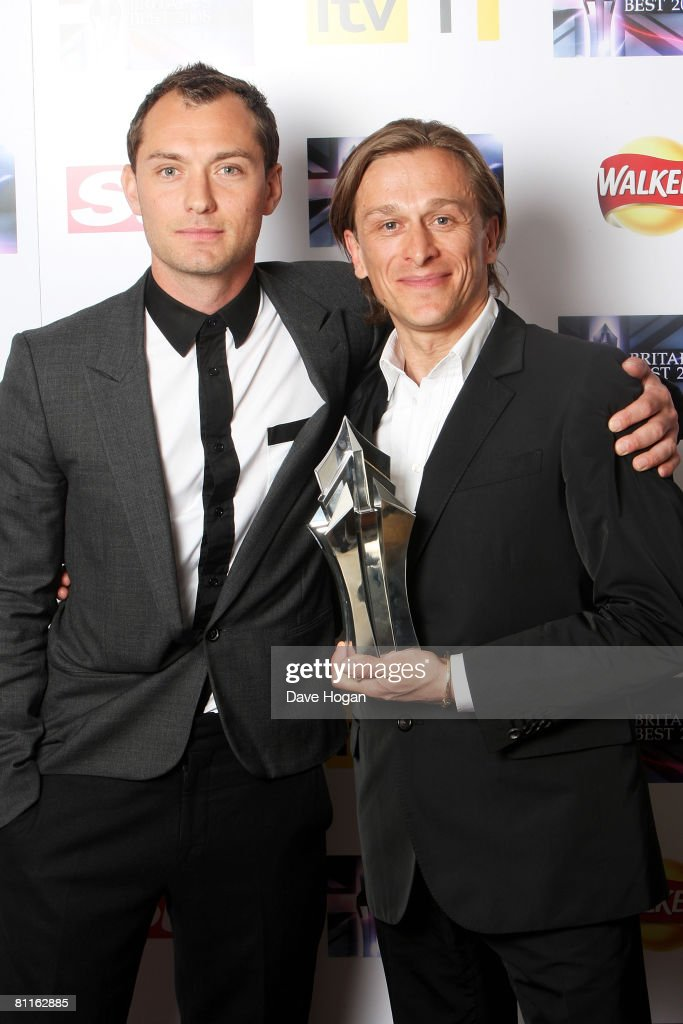 Actor Jude Law (L) and founder of the non-profit organisation Peace One Day Jeremy Gilley pose in front of the winners' boards with the latter's award for Britain's Best Campaigner at the Britain's Best 2008 Awards at London Television Studios on May 18, 2008 in London, England. The award ceremony honours outstanding Britons in categories including business, art, television, music, film, sport and fashion.