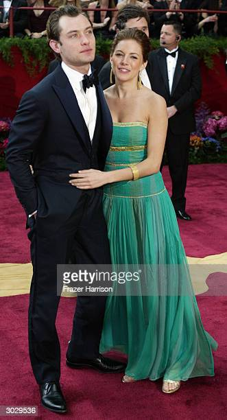 Actor Jude Law and girlfriend Sienna Miller attend the 76th Annual Academy Awards at the Kodak Theater on February 29 2004 in Hollywood California