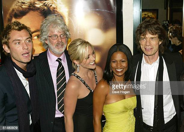 Actor Jude Law director Charles Shyer actresses Jane Krakowski and Nia Long and musician Sir Mick Jagger arrive at the World Premiere of Alfie at the...