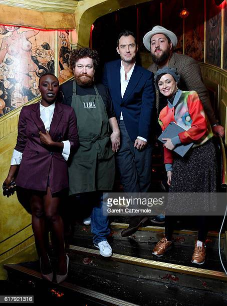 Actor Jude Law musician James GardinerBateman singer Laura Mvula head chef Alexei Zimin and Sabrina Mahfouz pose behind the scenes of The Life RX...