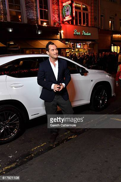 Actor Jude Law poses in front of his new Lexus RX during The Life RX Live a digital first improvised 'ontheroad' livestreamed performance in Soho...