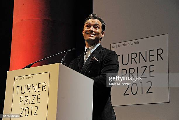 Actor Jude Law presents the Turner Prize 2012 at the winner announcement held at the Tate Britain on December 3 2012 in London England