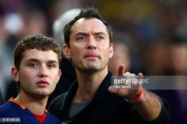 Actor Jude Law takes his seat next to his son Rafferty Law before the start of the La Liga match between FC Barcelona and Real Madrid CF at Camp Nou...