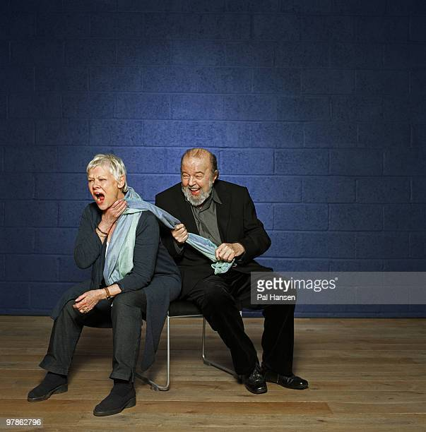 Actor Judi Dench with theatre director Peter Hall pose for a portrait shoot in London on February 2 2010
